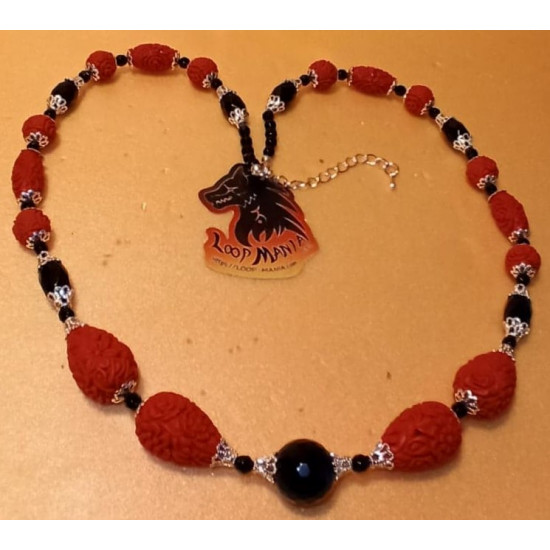 Necklace cinnamon and barrel onyx necklace, length about 54 cm + 5 cm silver-plated extension. Made of silicone wire, onyx faceted spheres and barrels, cinnabar spheres and tear spacer spacer and silver plated caps and silver lobster clasps.