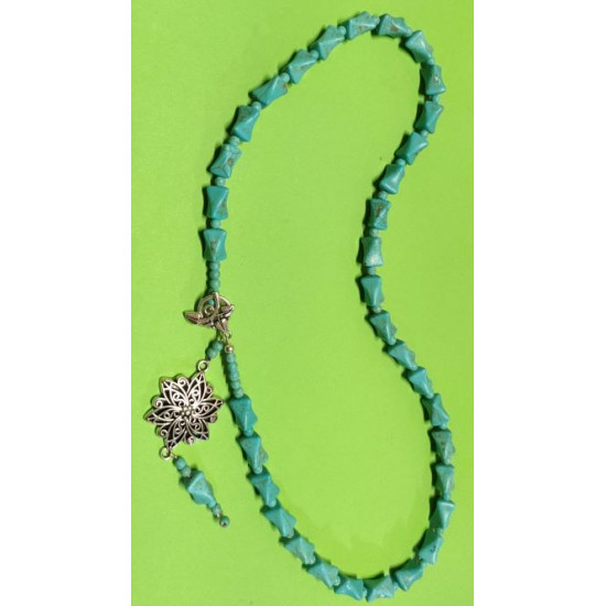 Necklace about 60 cm, The necklace is handmade on silicone wire, light blue hourglass howlit beads, Tibetan flower link with 3-leaf Tibetan clasp.