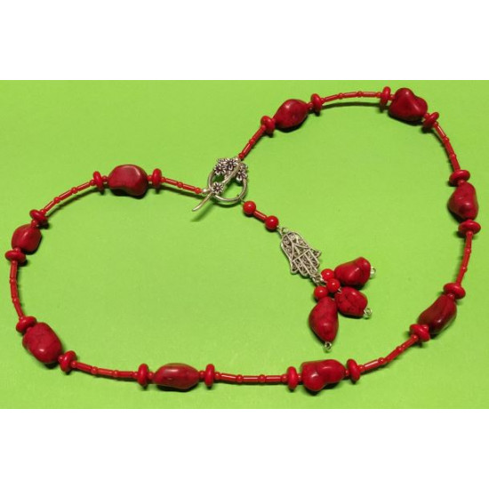 Necklace about 54 cm. Uneven stones howlite beads, synthetic and coral beads.