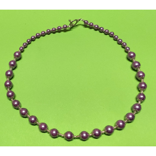 Necklace about 50 cm. Pearls made of purple (lilac) glass, and Tibetan silver caps