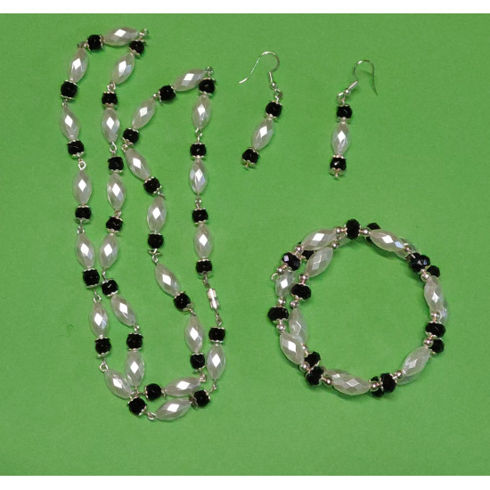 Set: necklace-earrings-bracelet. Necklace about 65 cm with toho beads, black and white acrylic pearls, silver beads, Tibetan silver caps.
