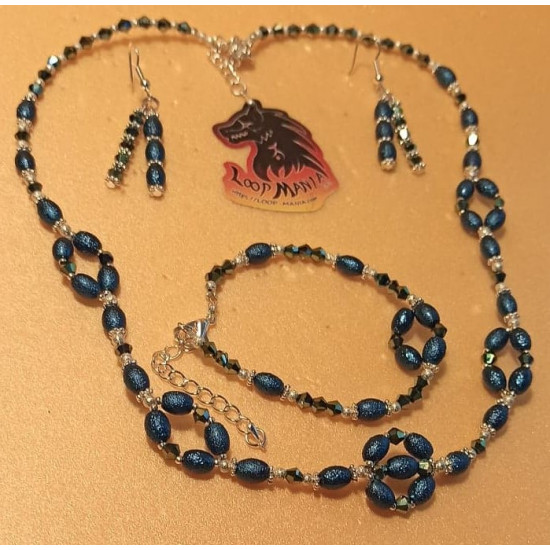 Set: necklace-earrings-bracelet made of blue oval stardust beads and electroplated biconical glass beads. Necklace about 52 cm + 5 cm extension plated with silver. Handmade on silicone wire, stardust oval beads and electroplated biconical glass beads, sil