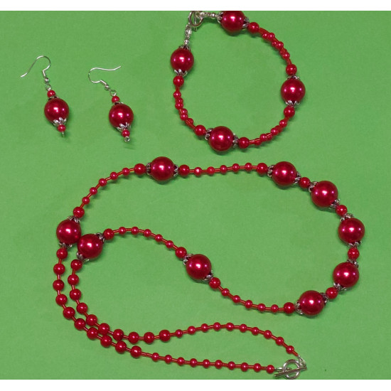 Set: necklace-bracelet. Necklace about 65 cm. Red glass beads, toho beads, Tibetan silver caps.